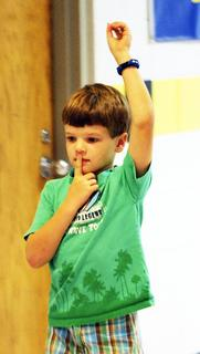 Mason-Corinth Elementary kindergartner Ben Curd, right, practices the sign for silence.