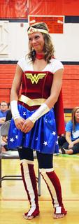 Sierra Staub dresses up as Wonder Woman as part of the Justice League to be auctioned off to the highest bidder.