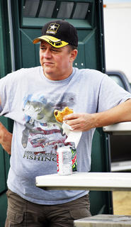 Rob Scroggins enjoys a sandwich and a Coke as he waits for the ATV Drag Race to start. 