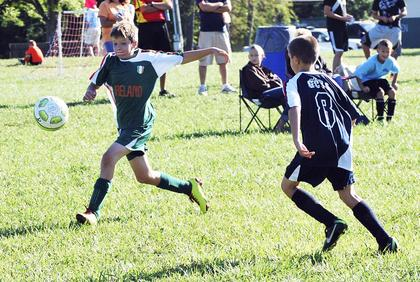 Timothy Staton of Team Ireland U13 tries to get to the ball before Matthew Kleinwachter of Team USA does. The final score was USA 3 and Ireland 2.