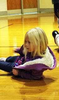 MCE student Hannah Monhollen practices how to stop, drop and roll.