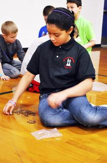 DRE students Angelica Martinez counts pennies for the 100 days of school. Dry Ridge Elementary donated all pennies collected to Relay for Life. 