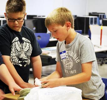Jemison Beavers and Tanner Issacs work together on a project. 