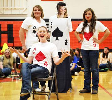 Ashley Williams, Ashley Simpson and Ashley Cook  and 'Ashley Kinman' (not present) dress up as four aces.