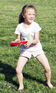 Summer Smith gets ready to throw the frisbee to one of her friends. 
