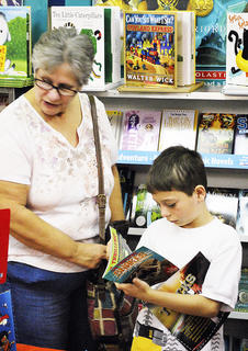 Grace Mullins points a book out to her grandson, Justin Chriest at the book fair.