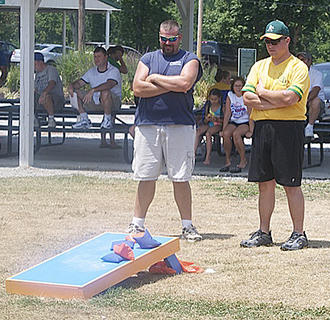 Phillip Smith and Brian Gibson enjoy a game of cornhole.