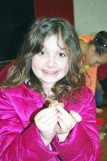 DRE student Kaylin Minton shows off her three pennies she donated to Relay for Life. 