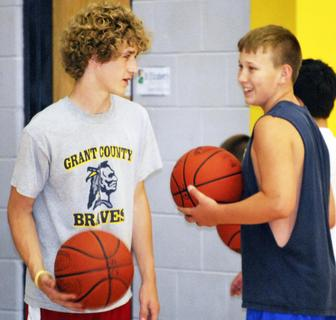 Zack Tuggle and Luke Atkins give each other pointers before heading back on the court.