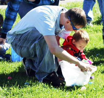 Bud Vance helps his son, Justin Vance find Easter eggs.