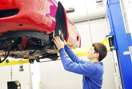 GCHS student Larry Tschaenn puts brakes on a vehicle in auto tech class.