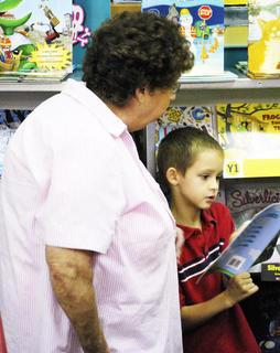 Wilma Goldsberry and her grandson, Coy Goldsberry look at a book. 