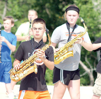 Jeff Kinman marches side to side with his saxophone at band camp.
