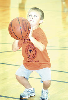 Chas Surrett makes sure to put all of his strength in his legs and arms into the foul shot while practicing free throws at camp.