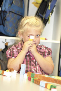  CMZ Elementary kindergartner Aubrey Hill peers through a Lego. 