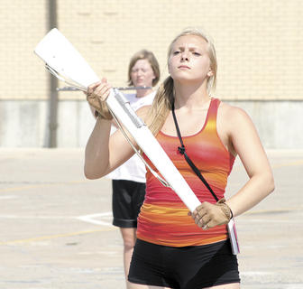Jacy Adams focuses during band camp as a member of the colorguard.