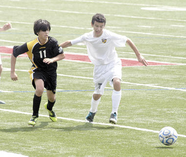 Brett Smith fights for position aganist a Carroll County player during Soccerama. 