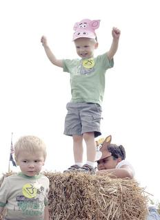 Lucas Courts of Dry Ridge celebrates making it to the top of the haystack.