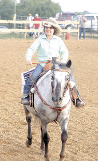Emilie Cook takes a ride on Lil' Smoky during the Grant County Only Horse Show on July 31. The fair 
