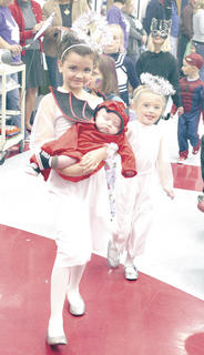 Kyliee Thompson, left, and Brooklyn Steinhauer, right, were angels with a cute lil' devil during the CMZ Fall Fest costume march. The girls won a ribbon for best overall costume.