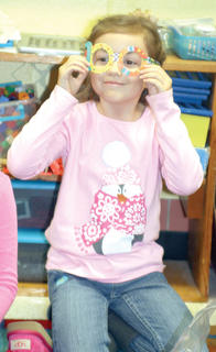 WES first grader Caden O'Connor tries on special glasses to celebrate the 100th day of school.