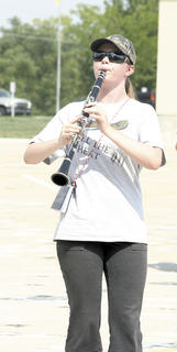 Hannah Riley braves the heat while playing the clarinet during band camp.
