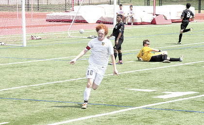 Forrest Schmidt celebrates after scoring the game-tying goal with six minutes left in a Soccerama scrimmage match against Carroll County Aug. 4 at Dixie Heights High School. The Braves finally finished after having several second half chances.