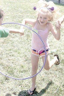 Chloe Linder takes a break from inventing to play a game with a hula hoop at Camp Invention at Williamstown Elementary School.