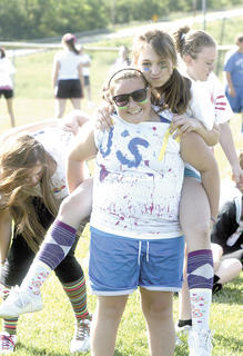 Seventh grade friends Mallory Palmer and Lynzie Cheek wear custom-designed T-shirts for track and field day.