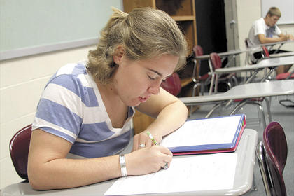 Williamstown High School senior Olivia Chandler takes notes in class. Photo by Alec Dalton