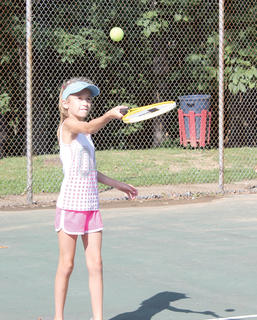 Kaia Lanter, left, practices juggling the ball during a Youth Tennis camp