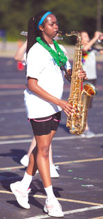 Bri Boulware marches with the Tenor Saxaphone