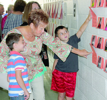 Tucker Mullins shows off his artwork on the wall of Williamstown Elementary.