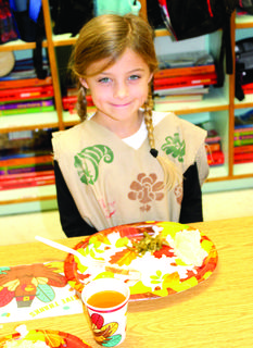 Bristol Cochran dresses for the occasion at the WES Thanksgiving feast.