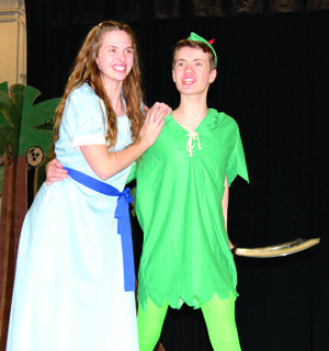 Williamstown High School will present the musical 'Peter Pan, Jr.'at 7 p.m. March 23 and 4 p.m. and 7 p.m. March 24 in the WHS cafeteria. Tickets are $10 for adults and $5 for children ages 3-17. They can be purchased online at wtowndrama.yapsody.com. Left: Jacob Mullins as Peter Pan protects Madison Whaley as Wendy.
