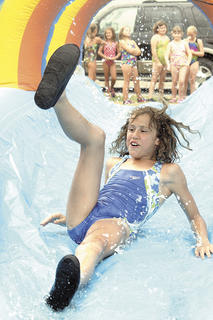 Tricie Tucker slips and falls as she attempts to exit the water slide at Summer Splash.
