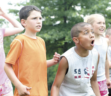 Ben Barker, left, and Bryce Lee, right, react to a relay race at Summer Splash camp. Photo by Seth Graham