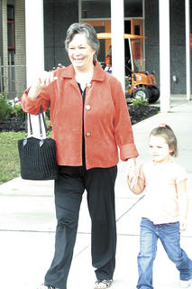 Kindergarten student Maleah Brown walks with her grandmother.