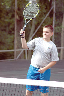 Ethan Dalzell readies his racket.