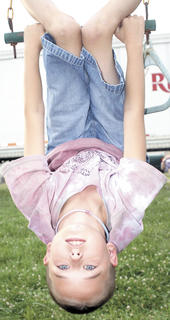 Shiloh Oliver hangs upside-down.
