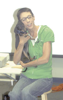 Kentucky author Leigh Ann Florence holds Woody, famous for his literary adeventures, close to her.