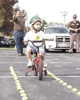 Jeremiah Bryl II of Dry Ridge Elementary participates in the GC Sheriff's Bicycle Rodeo.