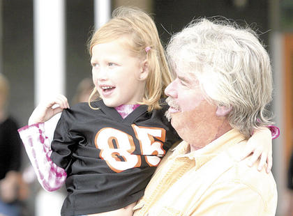 Williamstown Elementary kindergarten student Kaylie Dillingham gets carried by her grandpa on Sept. 9, when the school celebrated Grandparents' Day. The elementary school also dressed in Cincinnati Bengals attire and colors in hopes of winning a grant from the NFL.
