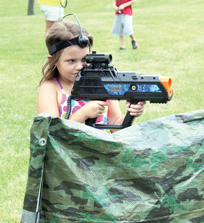 Kaitlynn Hartmann seeks out her target during a game of outdoor laser tag at Summer Splash camp. Photo by Bryan Marshall