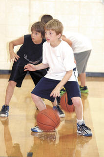 Brendan Morris and Nash Smith concentrate as they switch hands during a dribbling drill.