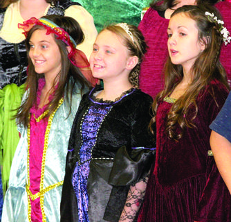 Sierra Fox, Ambry Shepherd and Emmarie Rosenstiel sing in their performance for the annual Renaissance Fair at Williamstown High School.