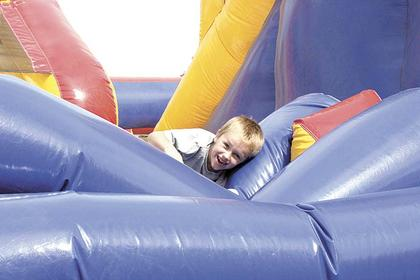 Dylan Baker of Dry Ridge tries to maneuver through an inflatable obstacle course.