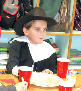 Second grader Cameron Baker waits on his food to be served. 