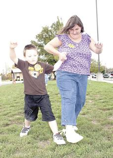 Dry Ridge resident Jamie Fryar, right, competes in the three-legged race with her son, Thomas.