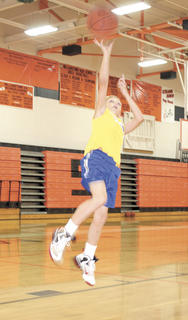 Tyler Osborne gets major air as he flies for a layup during a game of Hot Shot at the Mad Skills basketball camp at WHS.